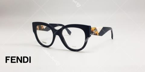 عینک طبی فندی - مدل گربه ای - کائوچویی دسته مشکی برا طرح سفید و قهوه ای - عکاسی وحدت - زاویه سه رخ