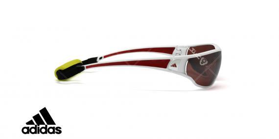 عینک آفتابی آدیداس با بند مخصوص - بدنه سفید قرمز - عدسی ها نقره ای پولاریزه - عکاسی وحدت - زاویه کنار