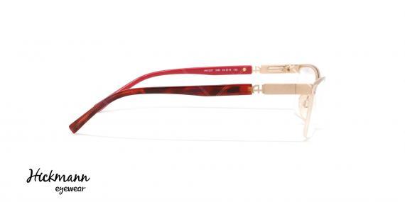 عینک طبی زیر گریف هیکمن - بدنه طلایی سر دسته قرمز هاوانا - عکاسی وحدت - زاویه کنار