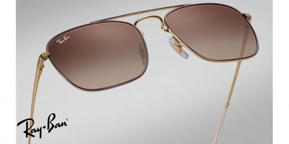 عینک آفتابی مربعی زاویه دار  ربین اصل - بدنه طلایی قهوه ای - عدسی قهوه ای - زاویه نزدیک